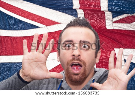 man with open mouth spreading tongue colored in great britain flag as symbol of values like teaching, learning, multilingual speaking different of languages - stock photo