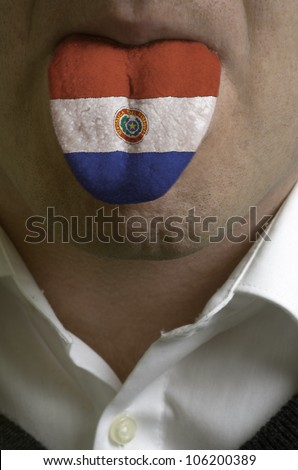 man with open mouth spreading tongue colored in paraguay flag as symbol of values like teaching, learning, multilingual speaking of different languages - stock photo