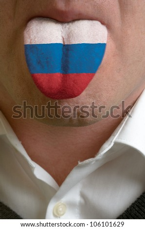 man with open mouth spreading tongue colored in russia flag as symbol of values like teaching, learning, multilingual speaking of different languages - stock photo