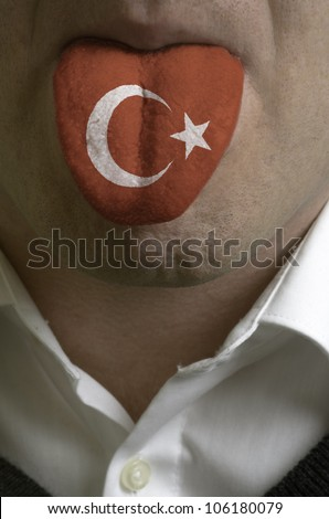 man with open mouth spreading tongue colored in turkey flag as symbol of values like teaching, learning, multilingual speaking of different languages - stock photo