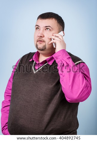 Man with overweight speaks on the phone - stock photo