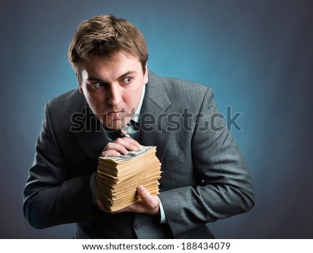 Man with pack of money  isolated on blue