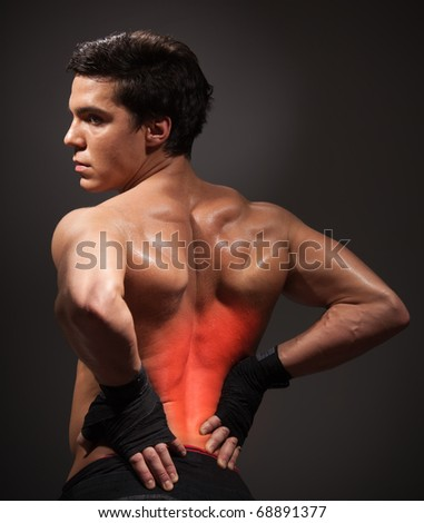 Man with pain his back highlighted with red holding waist