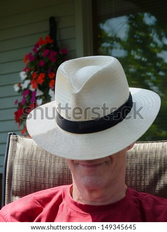 Man with Panama hat.