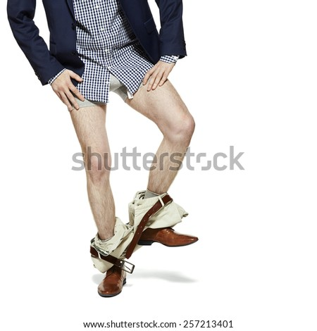 Man with pants down  standing on one leg. Isolated on white. - stock photo