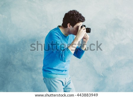Man with photo camera, photographer