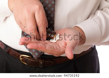 man with pill - blue white pills in man hand - stock photo