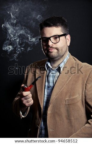 Man with pipe and glasses smoking