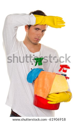 Man with polish. Cleaning the apartment. Home in the stress - stock photo