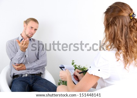 Man with problem on reception for  psychologist - stock photo