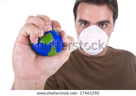 man with protection mask destroy  the earth globe with his hands - nature and  environment concept - stock photo