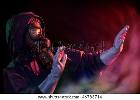 Man with protective equipment who enters into a gas zone - stock photo