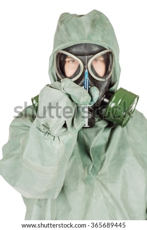 Man with protective mask and protective clothes holding a syringe with vaccine. Portrait isolated over white background. - stock photo