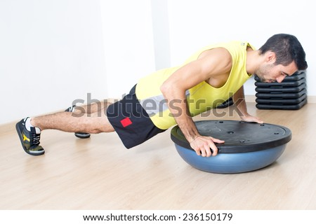 man with push ups on platform - stock photo