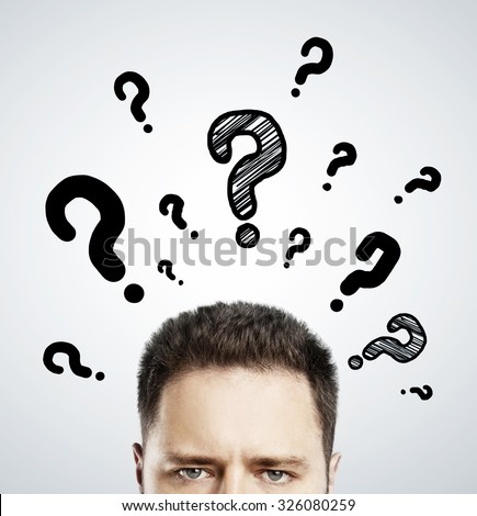 man with questions symbol over head on gray background