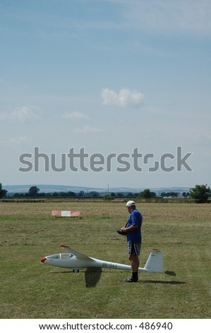 man with rc-glider plane model
