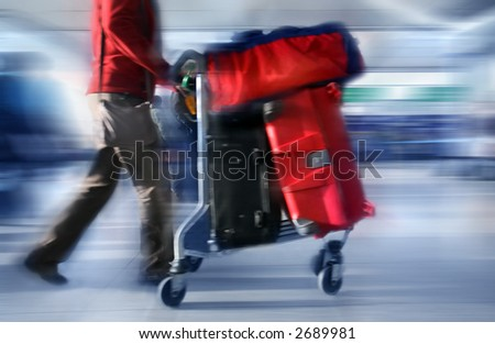 Man with red bags at the airport, motion blur - stock photo