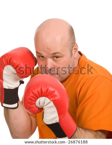 man with red boxing gloves on a white background - stock photo