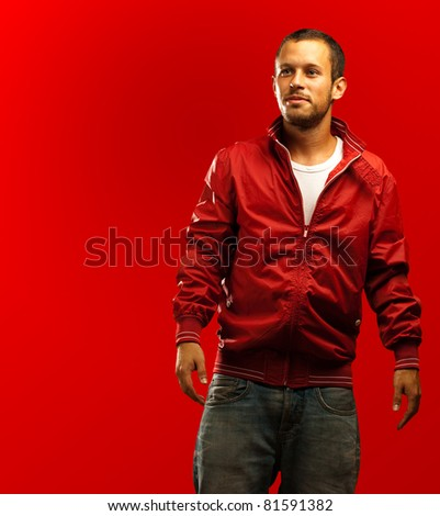 man with red jacket on a red background - stock photo
