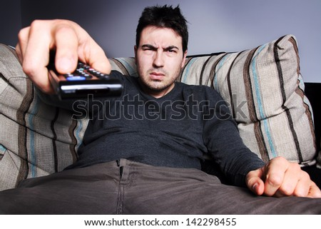 man with remote control - stock photo