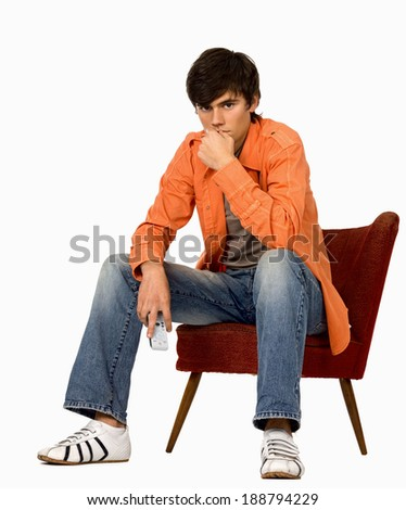 Man with remote on white.   - stock photo