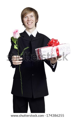 Man with rose and present in his hands - stock photo