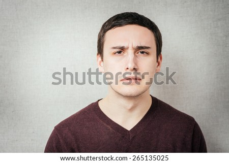 Man with sad expression - stock photo
