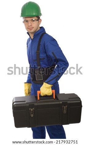 man with safety equipment, yellow, blue, green, black  - stock photo