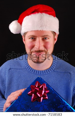 Man with Santa Claus hat and gift