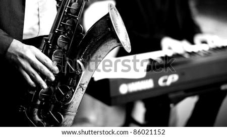 Man with sax , B&W conversion - stock photo