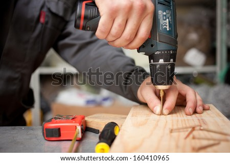 Man with screwdriver. Clouseup concept - stock photo