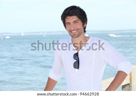 man with sea in the background - stock photo