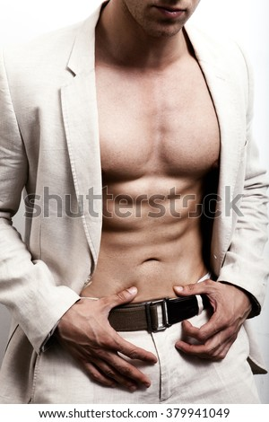 Man with sexy abs and elegant suit - stock photo