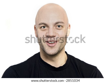 Man with shaved head smiling