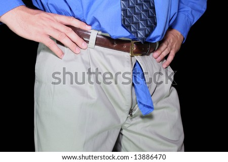 Man with shirt tail out zipper - stock photo