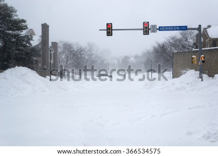 Man with shovel in the middle of the road. During deadly storm blizzard in virginia - stock photo