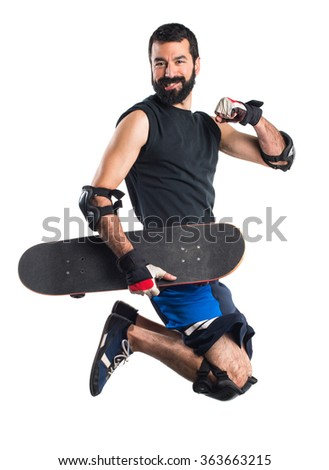 Man with skateboard jumping