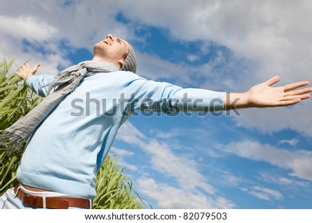man with sky and clouds - stock photo