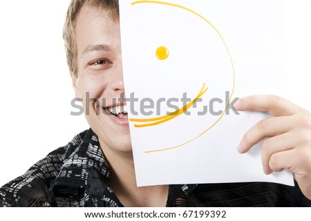 man with smiley on half of his face - stock photo