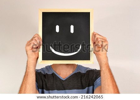 Man with smiling face in blackboard