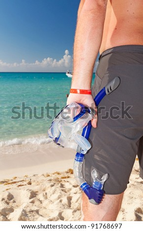 Man with snorkeling mask - stock photo