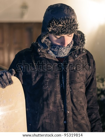Man with snowboard - stock photo
