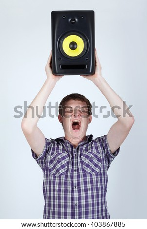 man with speaker loud shouting - stock photo