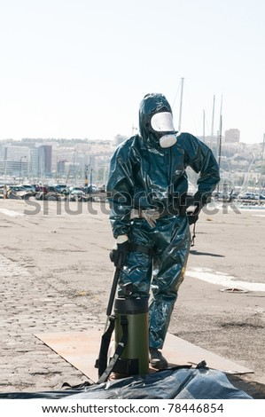 man with special ebola or virus dress or atomic contamination - stock photo