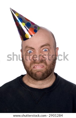 Man with strange expression wearing a party hat isolated over white - stock photo