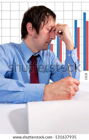 Man with stress holding his head - stock photo