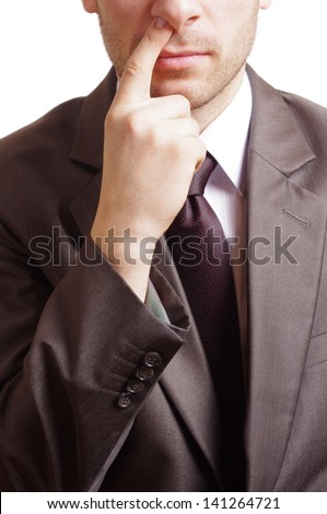 man with suit picking his nose - stock photo