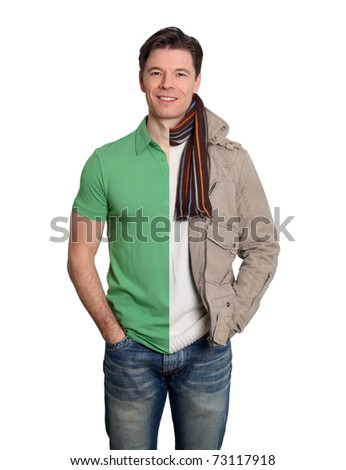 Man with summer and winter clothes - stock photo