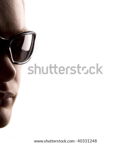 Man with sunglasses with white space for text - stock photo