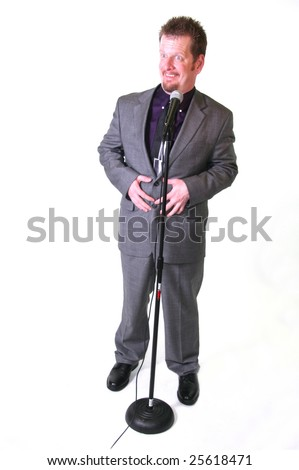 Man with surprise expression in front of microphone